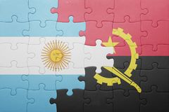 Puzzle with the national flag of angola and argentina Royalty Free Stock Image