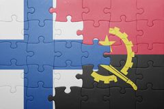 Puzzle with the national flag of angola and finland. Concept Royalty Free Stock Photo