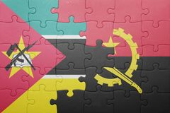Puzzle with the national flag of angola and mozambique Stock Photos