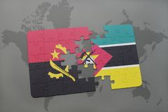Puzzle with the national flag of angola and mozambique on a world map. Stock Images