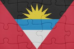 Puzzle with the national flag of antigua and barbuda. Concept royalty free stock photos