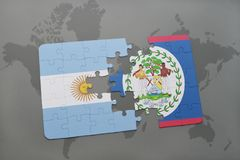 Puzzle with the national flag of argentina and belize on a world map background. Royalty Free Stock Photography