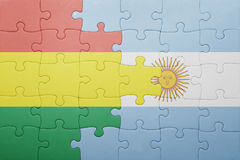 Puzzle with the national flag of argentina and bolivia Stock Images
