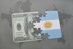 Puzzle with the national flag of argentina and dollar banknote on a world map background. Stock Images