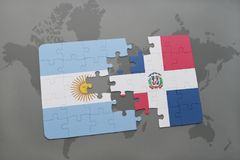 Puzzle with the national flag of argentina and dominican republic on a world map background. Royalty Free Stock Photography