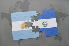 Puzzle with the national flag of argentina and el salvador on a world map background. Stock Image