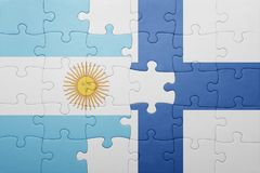 Puzzle with the national flag of argentina and finland. Concept Stock Photography