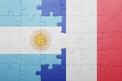 Puzzle with the national flag of argentina and france Royalty Free Stock Photography