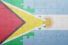Puzzle with the national flag of argentina and guyana Royalty Free Stock Image