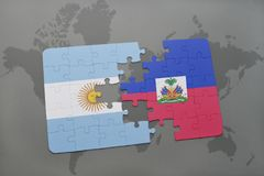 Puzzle with the national flag of argentina and haiti on a world map background. Royalty Free Stock Images