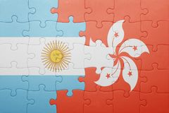 Puzzle with the national flag of argentina and hong kong Royalty Free Stock Photo