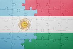Puzzle with the national flag of argentina and hungary Royalty Free Stock Photography