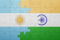 Puzzle with the national flag of argentina and india Royalty Free Stock Photo
