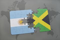 Puzzle with the national flag of argentina and jamaica on a world map background. 3D illustration royalty free stock image