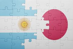 Puzzle with the national flag of argentina and japan Royalty Free Stock Photo