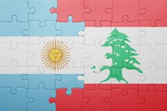 Puzzle with the national flag of argentina and lebanon Royalty Free Stock Photo