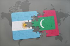 Puzzle with the national flag of argentina and maldives on a world map. Background. 3D illustration Stock Photos