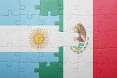 Puzzle with the national flag of argentina and mexico. Concept royalty free stock image