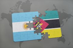 Puzzle with the national flag of argentina and mozambique on a world map Stock Photo