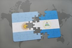 Puzzle with the national flag of argentina and nicaragua on a world map background. Stock Photo