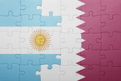Puzzle with the national flag of argentina and qatar Royalty Free Stock Photography