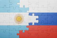 Puzzle with the national flag of argentina and russia Stock Photo