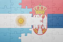 Puzzle with the national flag of argentina and serbia . concept Royalty Free Stock Image