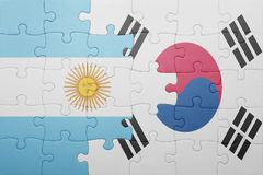 Puzzle with the national flag of argentina and south korea. Concept stock images
