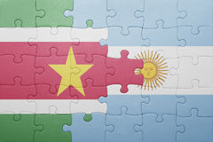 Puzzle with the national flag of argentina and suriname Stock Images