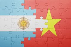 Puzzle with the national flag of argentina and vietnam Royalty Free Stock Images