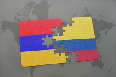Puzzle with the national flag of armenia and colombia on a world map Royalty Free Stock Photos