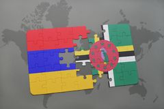 Puzzle with the national flag of armenia and dominica on a world map Stock Photo