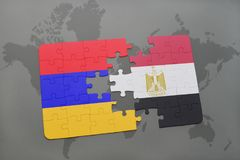 Puzzle with the national flag of armenia and egypt on a world map Royalty Free Stock Photos