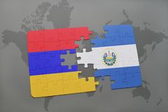 Puzzle with the national flag of armenia and el salvador on a world map Stock Images