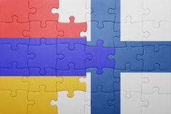 Puzzle with the national flag of armenia and finland Stock Photos