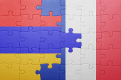 Puzzle with the national flag of armenia and france Stock Photo