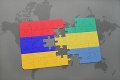 Puzzle with the national flag of armenia and gabon on a world map Stock Photo