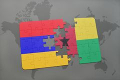Puzzle with the national flag of armenia and guinea bissau on a world map Stock Images