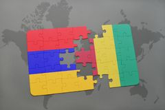 Puzzle with the national flag of armenia and guinea on a world map Stock Photo