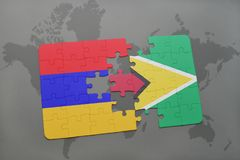 Puzzle with the national flag of armenia and guyana on a world map Royalty Free Stock Photos