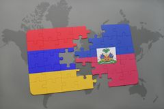 Puzzle with the national flag of armenia and haiti on a world map Stock Photo