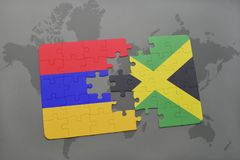 Puzzle with the national flag of armenia and jamaica on a world map Royalty Free Stock Photos