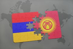 Puzzle with the national flag of armenia and kyrgyzstan on a world map Stock Images