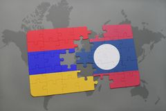 Puzzle with the national flag of armenia and laos on a world map Stock Photo