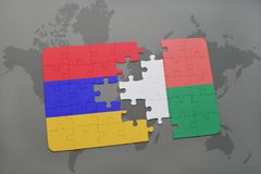 Puzzle with the national flag of armenia and madagascar on a world map Stock Photography