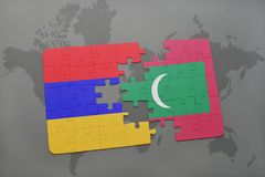 Puzzle with the national flag of armenia and maldives on a world map Stock Photo