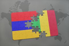 Puzzle with the national flag of armenia and mali on a world map Stock Images
