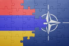 Puzzle with the national flag of armenia and nato Stock Images