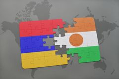 Puzzle with the national flag of armenia and niger on a world map Stock Photography