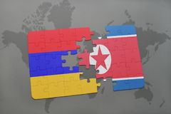 Puzzle with the national flag of armenia and north korea on a world map Royalty Free Stock Photos